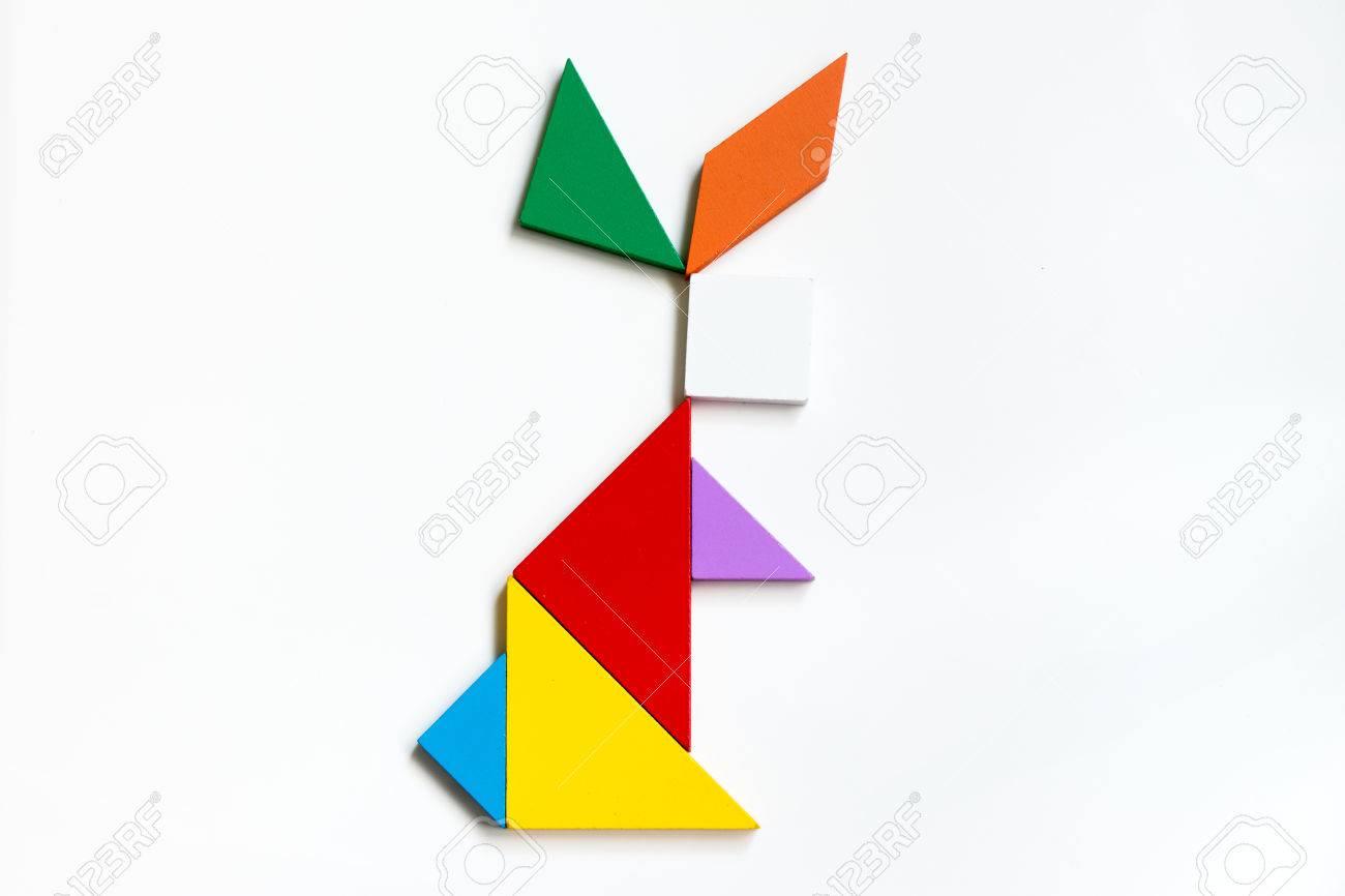 Colorful Wood Tangram Puzzle In Sitting Rabbit Shape On White.. tout Tangram Lapin