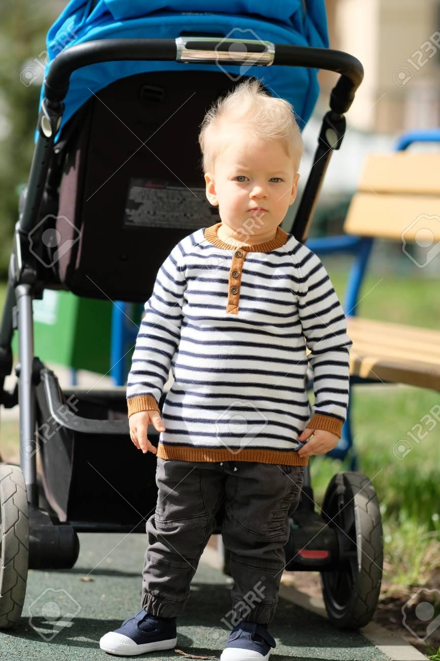 Portrait D'un Tout-Petit Enfant À L'extérieur. Bébé D'un An À L'aire De Jeux concernant Jeux Tout Petit